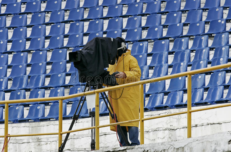 Download A Cameraman Filming A Football Game On A Stadium Stock Image - Image: 21692787