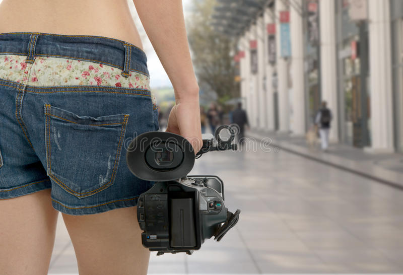 Cameraman girl holding his professional camcorder in the street. A cameraman girl holding his professional camcorder in the street stock photos
