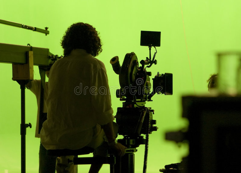 Cameraman on greenscreen stock photography