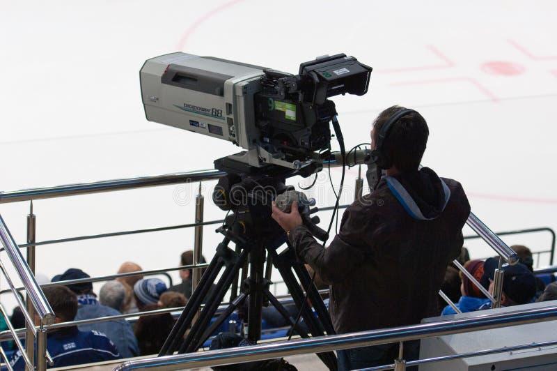 Cameraman op sportevenement stock foto's