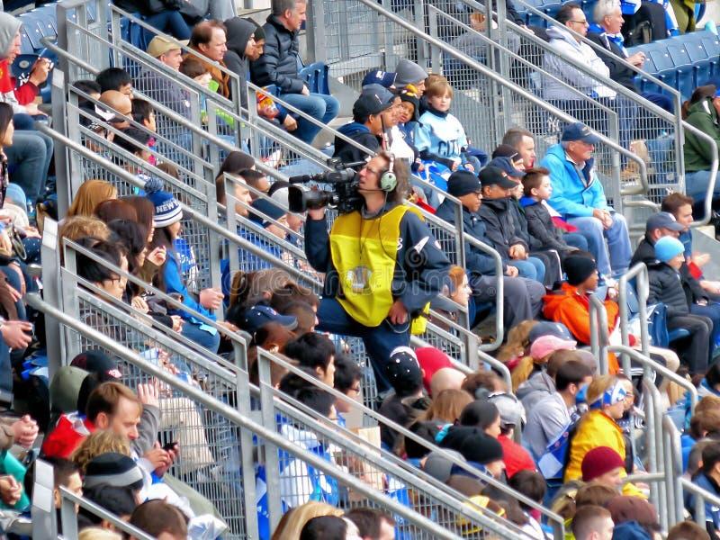 Cameraman op Yankee Stadium stock afbeelding