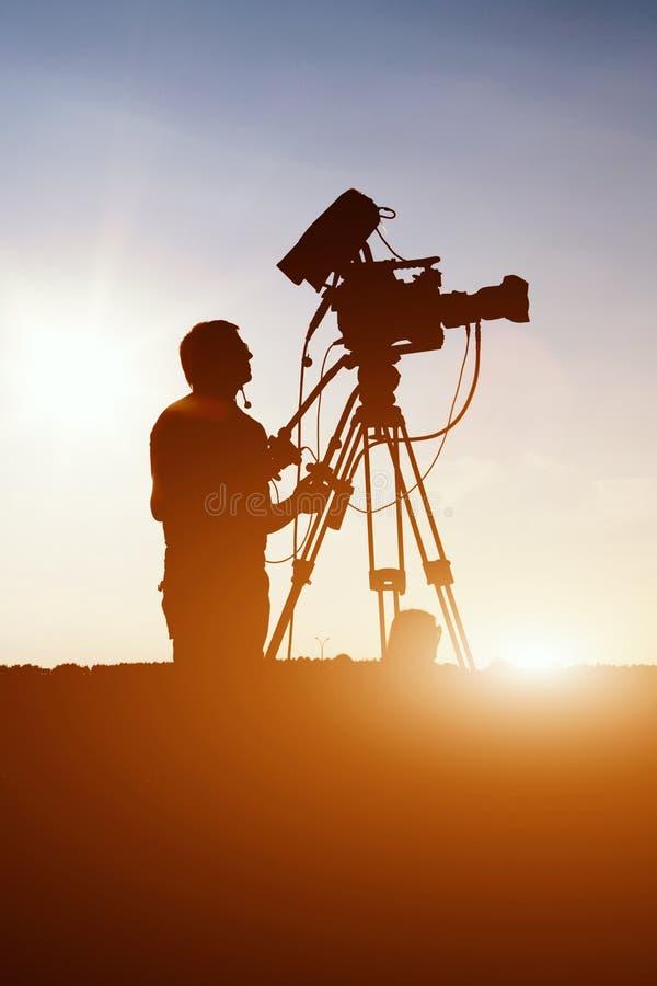 Cameraman operator shooting a summer rock concert royalty free stock photos