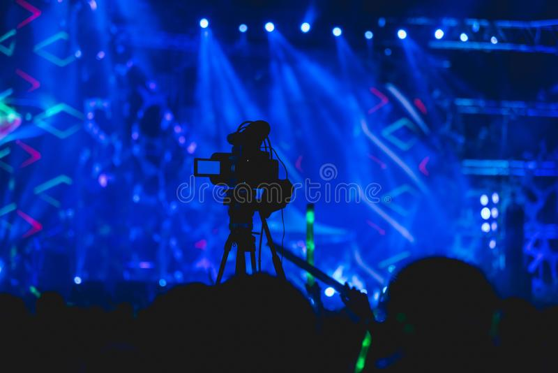 Cameraman shooting video production camera videographer. In concert music festival stock image