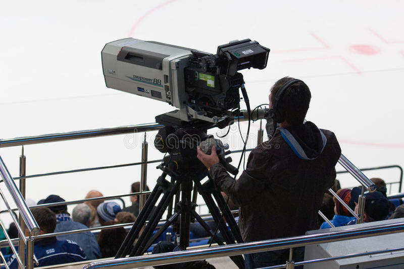 Cameraman on sport event stock photos