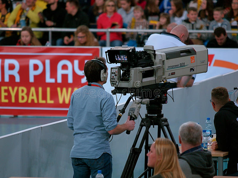 Cameraman sports. TV cameraman while recording transmission Champions League match in the retina in Lodz stock image
