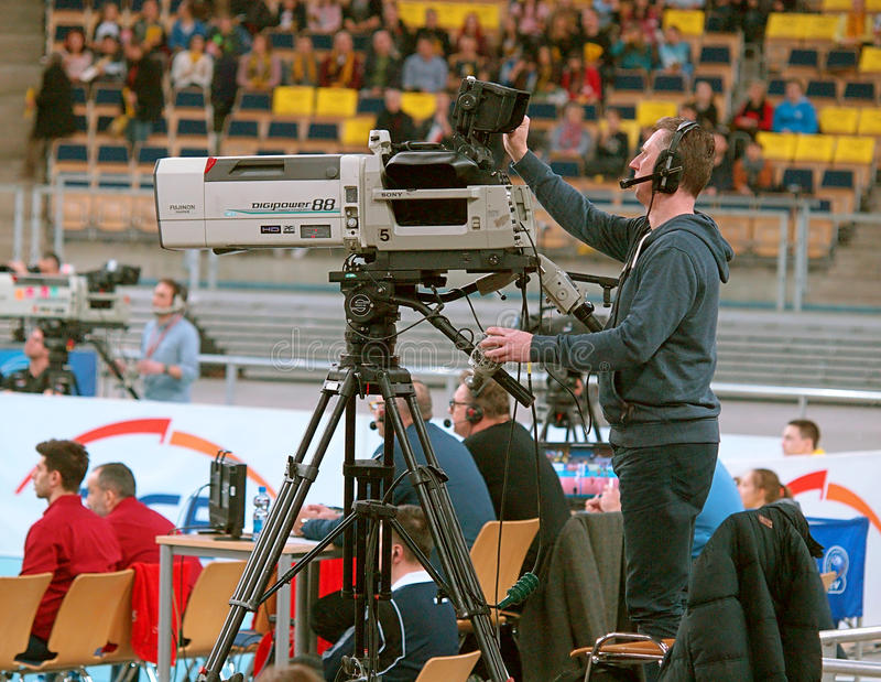 Cameraman sports. TV cameraman while recording transmission Champions League match in volleyball in Lodz stock photo