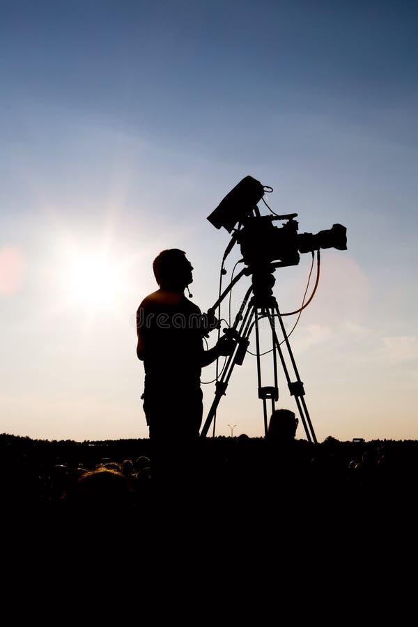 Cameraman tirant un concert vivant images stock