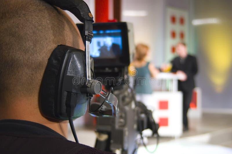 Cameraman in TV studio. Cameraman works in the studio