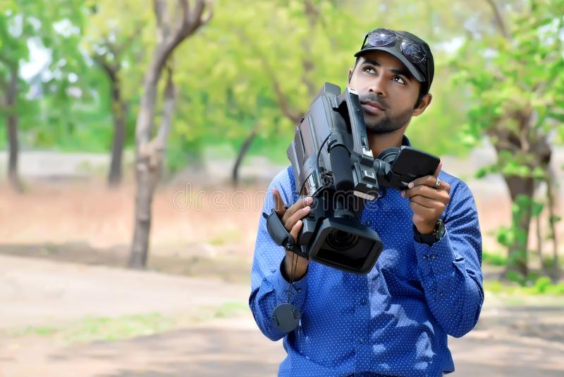 Cameraman using a professional camcorder outdoor. For a filming documentary stock images