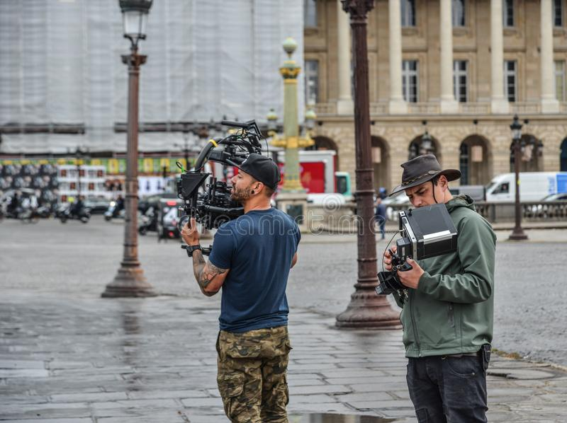 Cameraman using professional camcorder. Paris, France - Oct 3, 2018. Cameraman using professional camcorder on the street of Paris, France royalty free stock photo