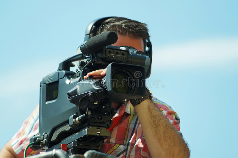 Cameraman is working. Outdoors in summer royalty free stock photo