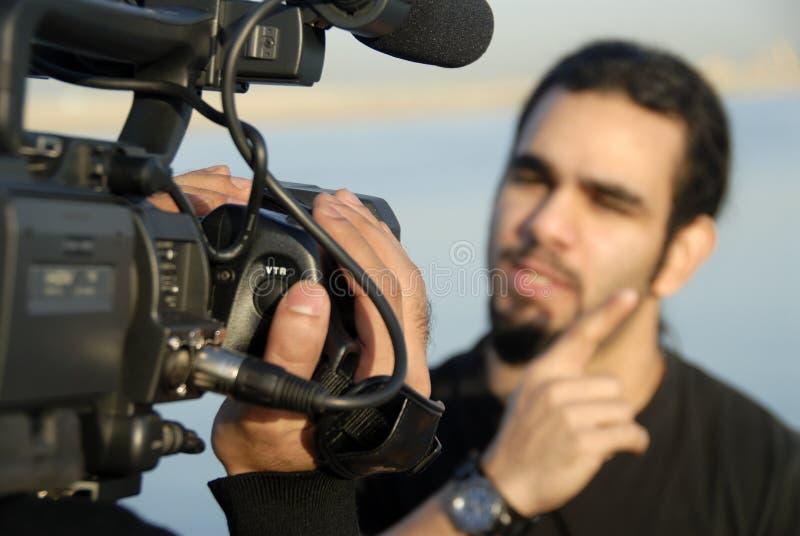 Cameraman y ordenador principal imágenes de archivo libres de regalías