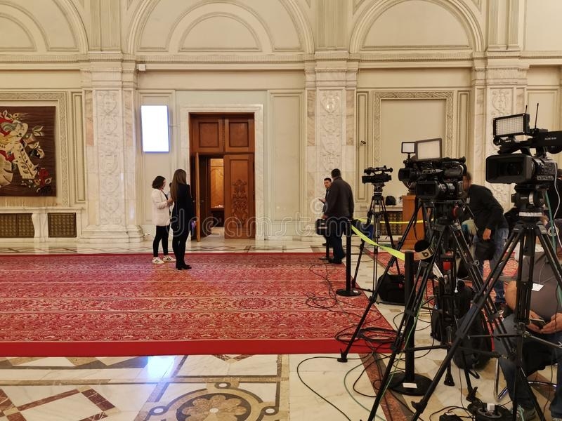 Cameramen ready for press conference. Cameras ready for press conference at the Chamber of Deputies, Parliament Palace, Romania stock images