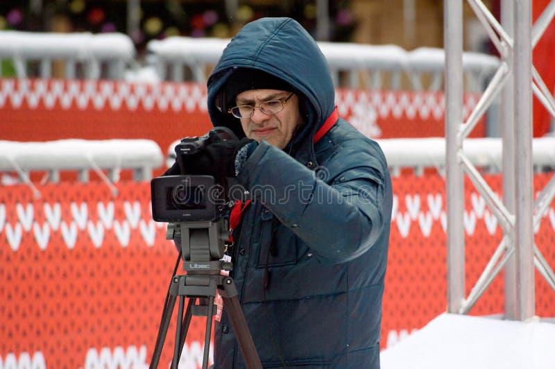 Cameramens het werken stock afbeeldingen