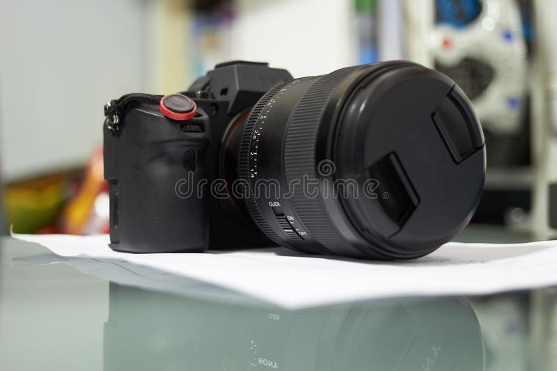 Camerand lens on table on blur background royalty free stock photos