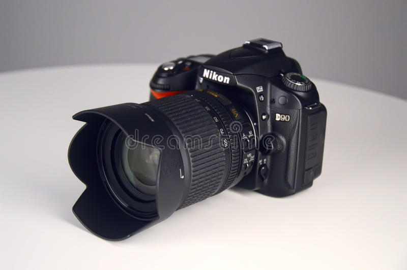 Cameras Nikon D90 on a white background. Cameras Nikon D90 phototechnique Photo royalty free stock photography