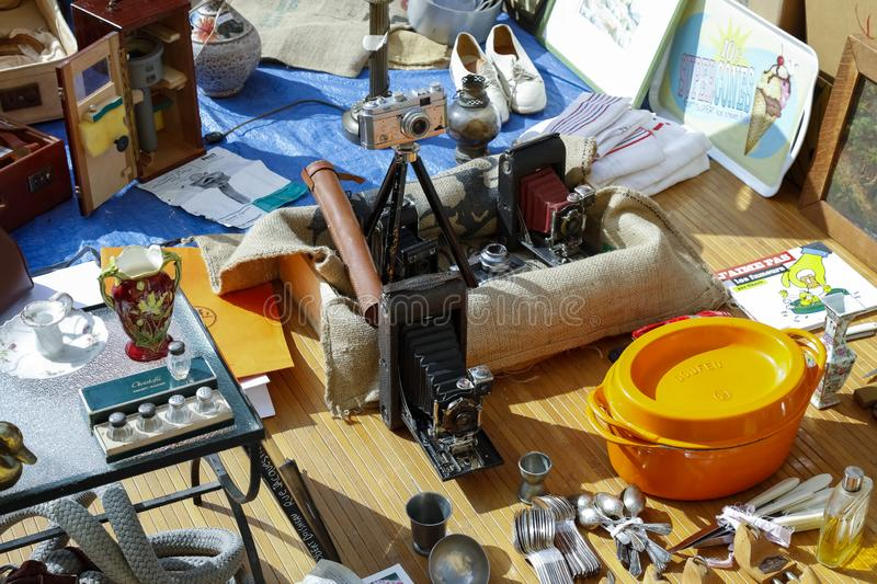 Cameras among other old items. Nice, France - September 24, 2018: Cameras and other old items are available for sale during the trading day at Cours Saleya stock photo