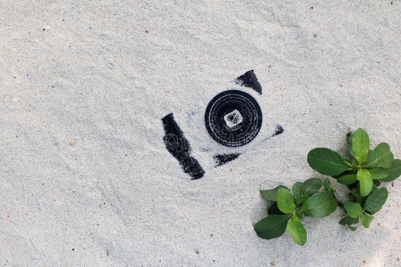 Cameras in the sand. Cameras in the sand on the beach stock photos
