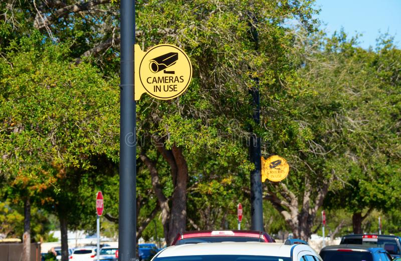 CAMERAS IN USE signs at parking lot for security to stop crime royalty free stock images