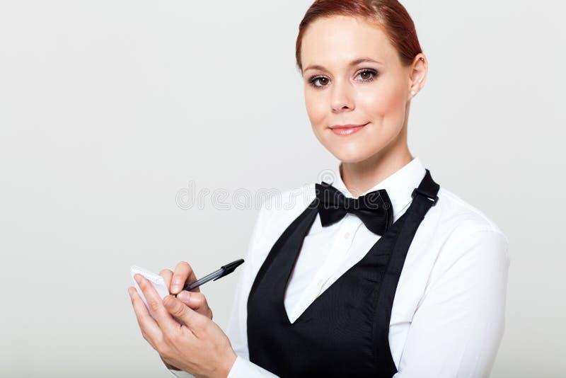 Cameriera di bar che cattura gli ordini immagini stock libere da diritti