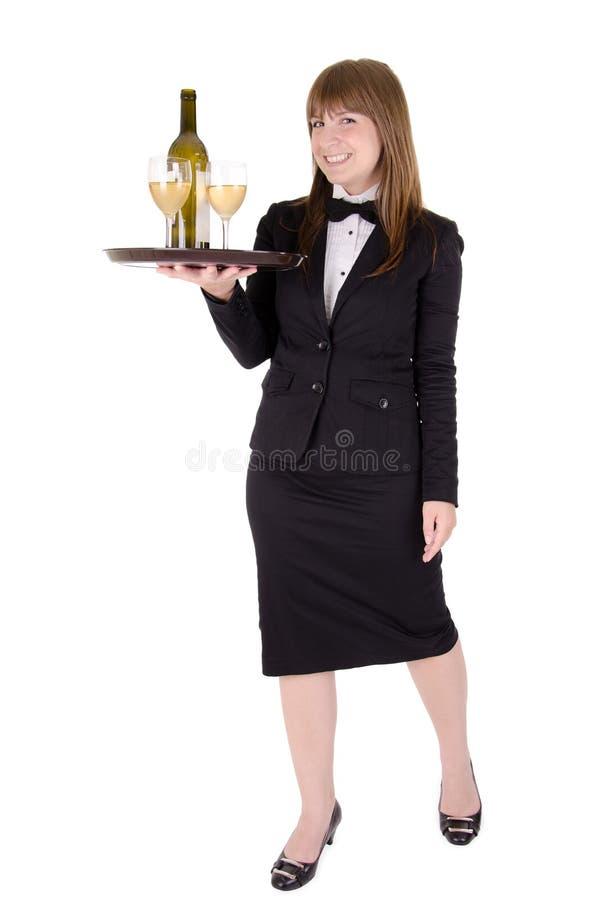 Cameriera di bar con un cassetto dei bicchieri di vino fotografia stock