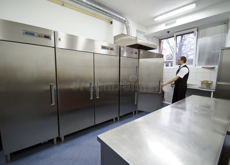 Cameriere e frigoriferi immagine stock