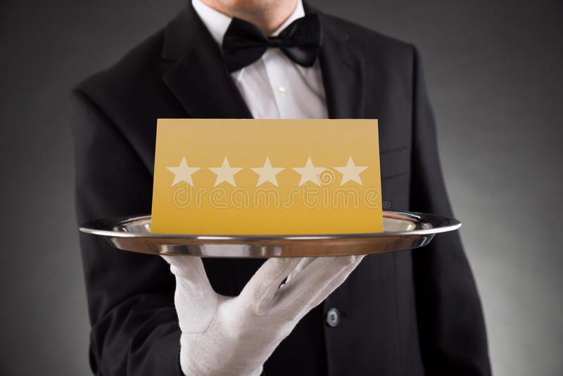 Cameriere Serving Star Rating fotografie stock
