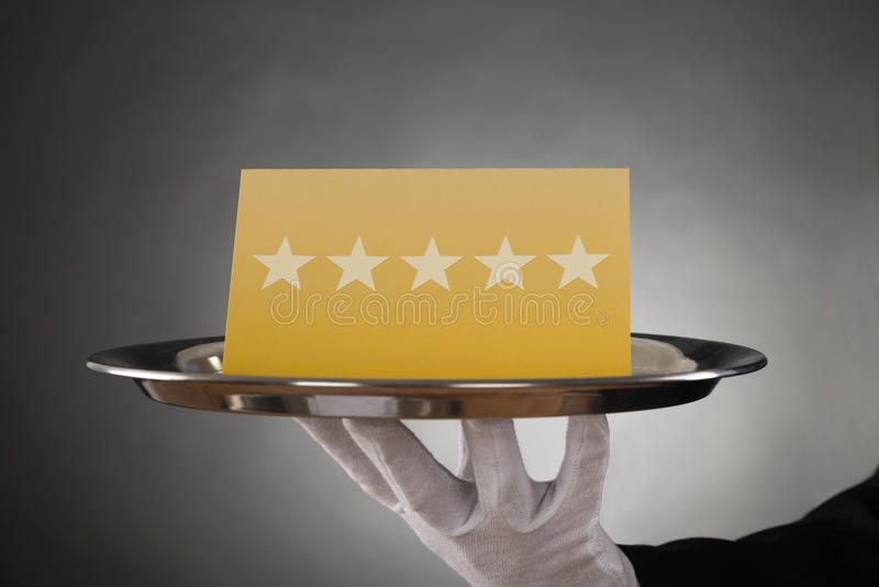 Cameriere Serving Star Rating fotografia stock