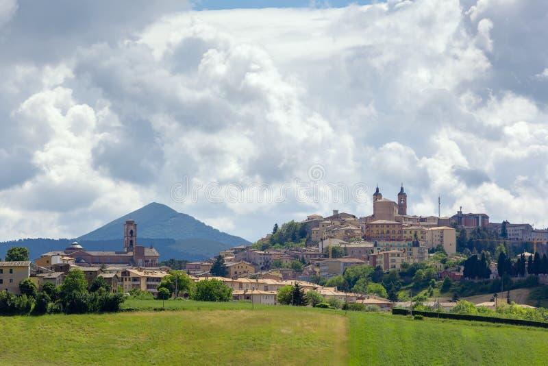 Camerino in Italy Marche over colourful fields stock image