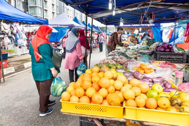 CAMERON HIGHLANDS, MALAYSIA, APRIL 6, 2019: Tourist and shoppers shopping fresh agriculture produce from street stalls market,. CAMERON HIGHLANDS, MALAYSIA royalty free stock photo