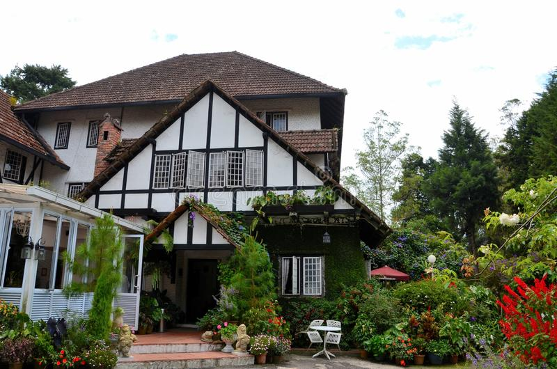 Main entrance to colonial era Tudor style bungalow cottage now a hotel Cameron Highlands Malaysia. Cameron Highlands, Malaysia - June 8, 2017: The main entrance stock photography