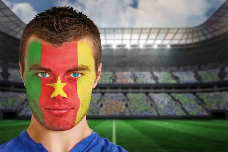 Cameroon fan piłki nożnej w twarzy farbie zdjęcie royalty free