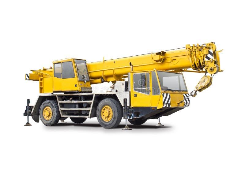 Camión amarillo de la grúa móvil imagenes de archivo