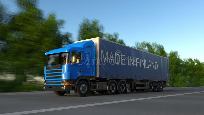 Camión de la carga que apresura semi con HECHO EN el subtítulo de FINLANDIA en el remolque Transporte del cargo del camino repres imágenes de archivo libres de regalías