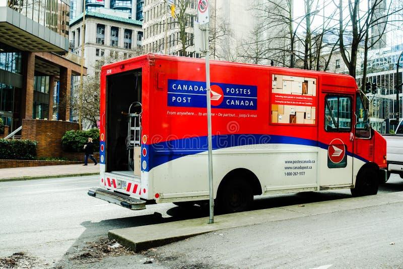 Camión de reparto de los posts de Canadá en Vancouver imagen de archivo