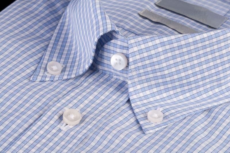 Camicia blu con il collare button-down fotografie stock libere da diritti