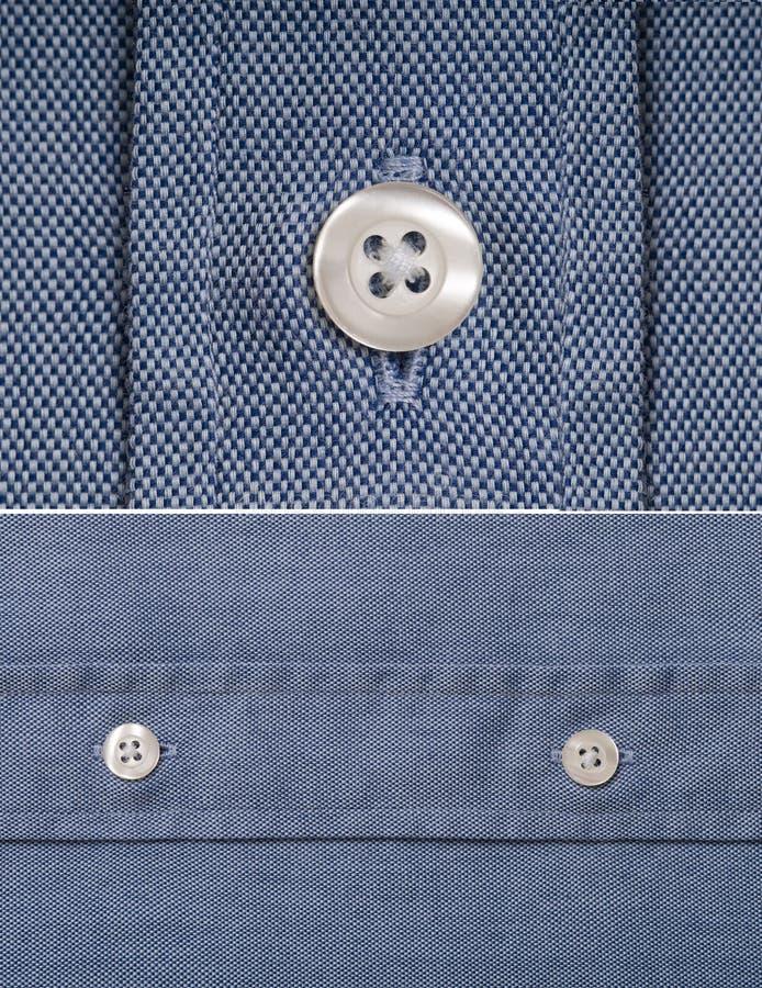 Camicia blu - particolare del tasto immagine stock