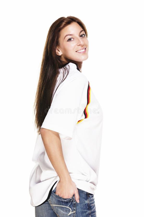 Camicia da portare felice di gioco del calcio della giovane donna che gira a fotografie stock libere da diritti