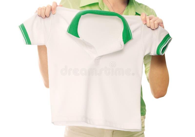 Camicia di polo della tenuta della mano delle donne immagini stock libere da diritti