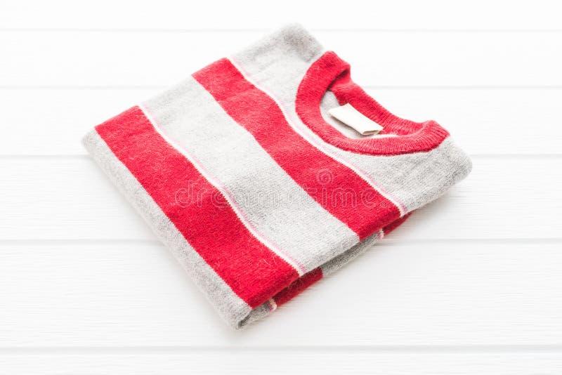 Camicia e abbigliamento del maglione della lana fotografia stock