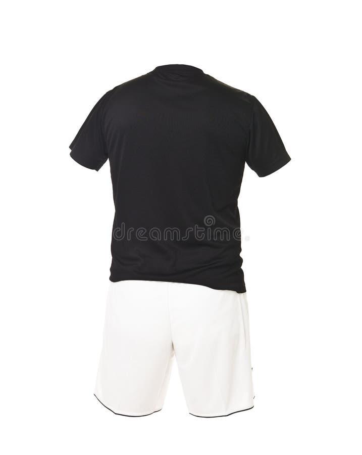 Camicia nera di gioco del calcio con gli shorts bianchi immagine stock libera da diritti