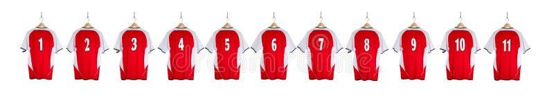 Camicia rossa di calcio in una fila fotografia stock libera da diritti