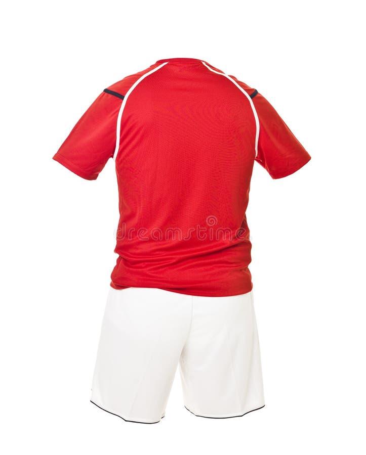 Camicia rossa di gioco del calcio con gli shorts bianchi fotografie stock libere da diritti