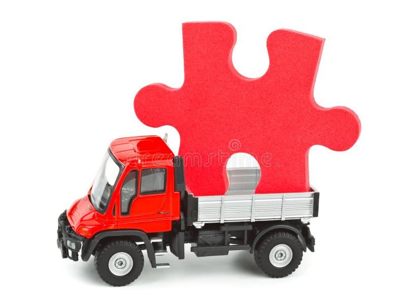 Caminhão do brinquedo com enigma fotografia de stock