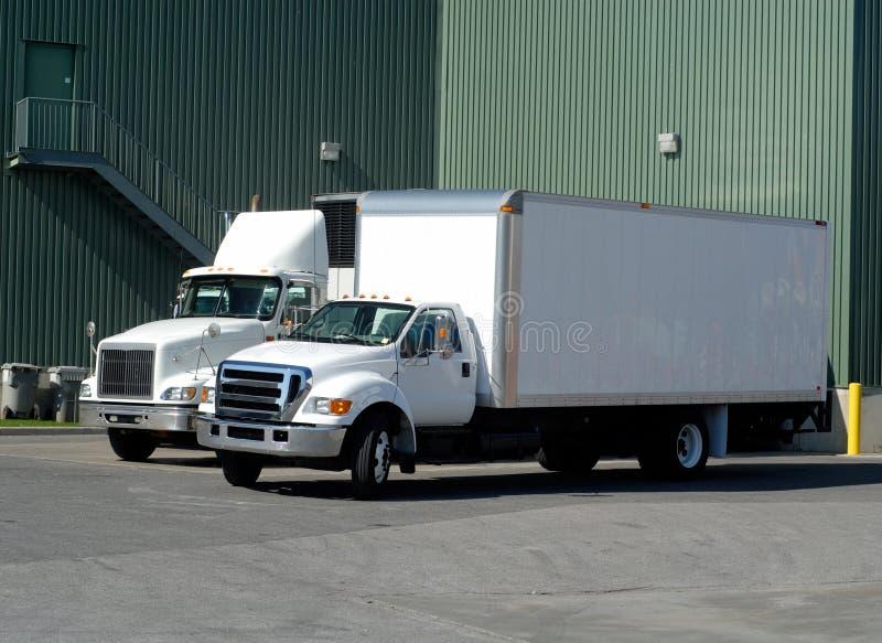 Caminhões de entrega fotos de stock