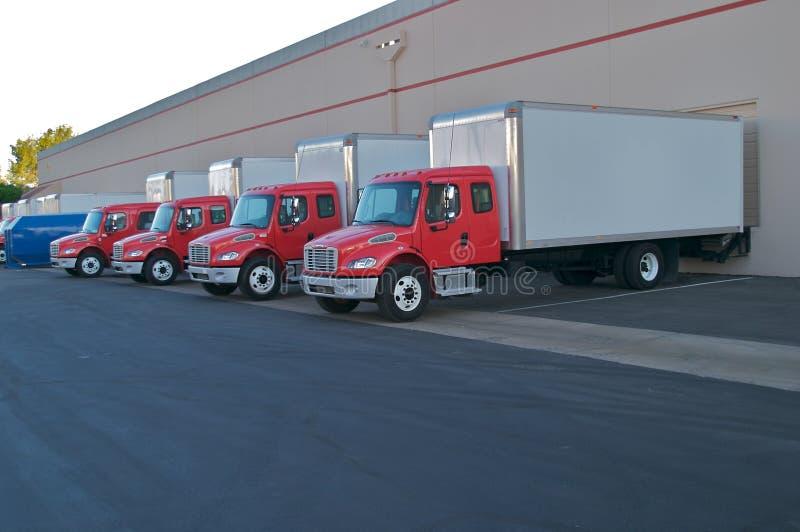 Caminhões de entrega imagem de stock