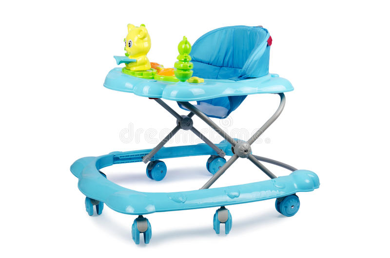 Caminhante do bebê com os brinquedos isolados no branco fotos de stock royalty free