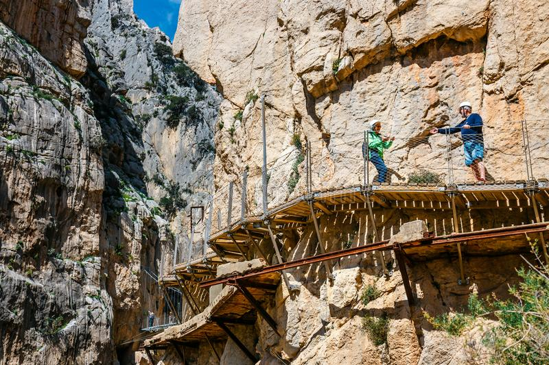 Tourists walk along the El Caminito del Rey, Malaga, Spain stock images