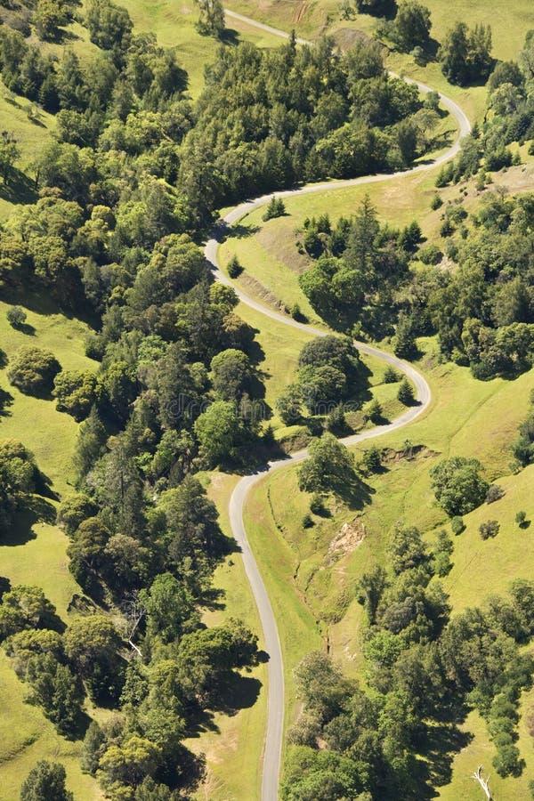 Camino curvy rural. imagenes de archivo