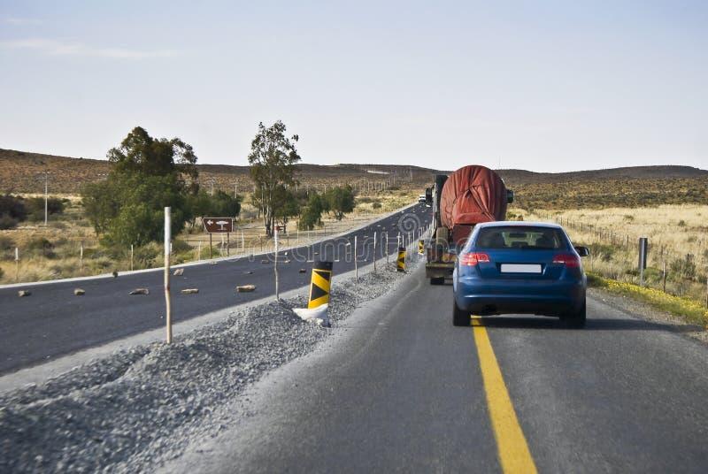 Camino de Tempoary, solo tráfico del carril fotografía de archivo libre de regalías